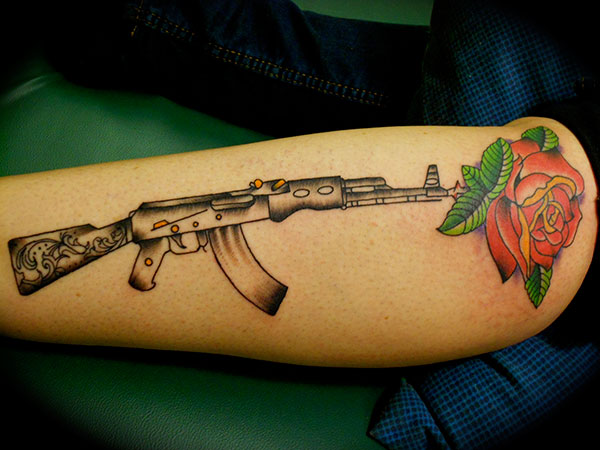 americana style rifle and rose tattoo