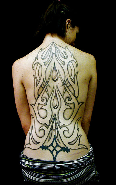 mehai-bakaty-flames-outline-backpiece-tattoo