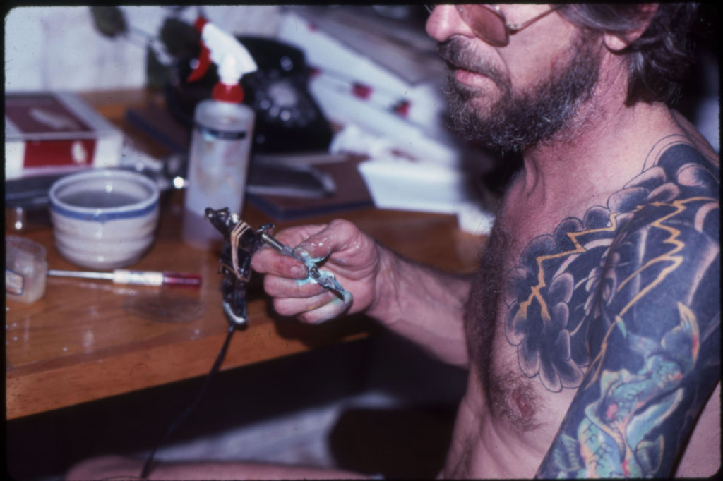 Mike Bakaty in his shop at 295 Bowery, Lower East Side. Photo is from the late 1970s.