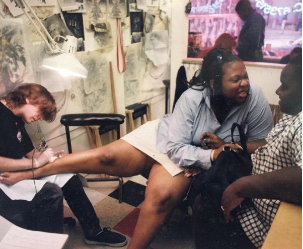 Some New York walk-in street shop action around 1999. Girl's first tattoo.